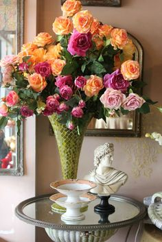 Festive roses in a mosaic vase look pretty with the old French porcelain compotes