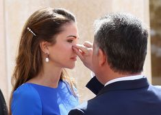 So sweet! Prince and princess. How caring he is! (Rania is wearing Antonio Berardi.)