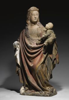A FRENCH GOTHIC STONE GROUP OF THE MADONNA AND CHILD, 15TH CENTURY.