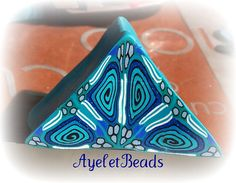 Polymer Clay Kaleidoscope cane In blues, via Flickr.