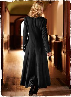 Our ultra-luxe maxi coat is tailored of sumptuous baby alpaca (67%), wool (31%) and nylon (2%). Detailed with a stand collar, angled seaming and metal buttons that lend a hint of military styling through the fitted shoulders and torso. The timelessly chic silhouette releases in godets to a dramatic flared hem. Fully lined.