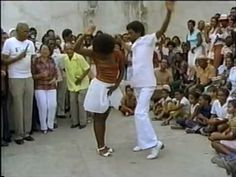 the mid-19th Century, Rumba first emerged as a gathering, a dance and music performed by laborers of African descent, mostly dockworkers, in Matanzas, Cuba. A synthesis of African cultural elements, including religious music, the Afro-Cuban Rumba is entirely secular. Rumba was originally performed on everyday objects to avoid the ban on African instruments. A wine barrel was played like a drum, a wooden crate was tapped on with spoons, and the shipyard's hardwood dowels were struck together…