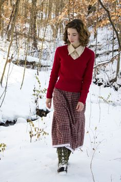 Ruby is a lovely color for wintertime. A simple sweater and plaid skirt just seem so warm.