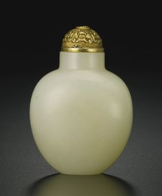 A WHITE JADE SNUFF BOTTLE QING DYNASTY, 1750-1880 of oval section, gently tapering towards the base, supported on a flat foot, the interior well-hollowed, the stone an even white color with some opaque inclusions