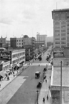 SW 6th Avenue, 1910 -   This is a lovely view down SW 6th Avenue one hundred years ago. Horses still outnumber automobiles by a large margin on the wide streets. The 1907 Wells Fargo building on the right, between SW Oak and Stark, is Portland's first steel-framed building and is considered the city's first skyscraper.
