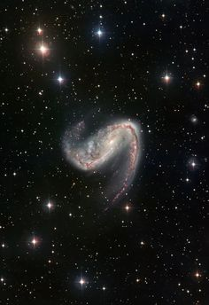 Wide Field Galaxy Hook | #GalaxyHook, also called #NGC2442, is located in the area of the sky that occupies the southern constellation of Volans (The Flying Fish), it is easily recognized for its asymmetric spiral arms. The twisted appearance of the galaxy is thought to be due to gravitational interactions with another galaxy at some point in its history, though astronomers have not so far been able to positively identify the galaxy that has interacted with her.