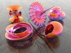 """These five objects were created by graphic artist Luc Benard with the 3D-XplorMath program developed by Richard Palais of UC Irvine. """"True beauty can be found in mathematics,"""" Palais says."""