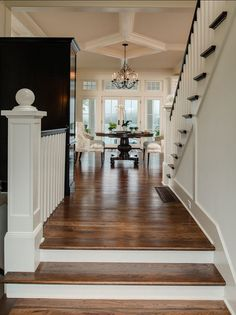 "Traditional Entryway Design with hardwood floors and millwork. Hardwood flooring is Hickory with ""Antique Walnut"" stain."