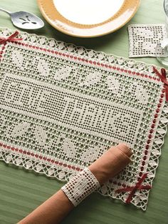 """Give Thanks! - Add a touch of elegance to your Thanksgiving table with this lacy filet set. This e-pattern was originally published in Crochet World October 2008. Skill Level: Experienced Size: Place Mat: 17-3/4"""" x 12-1/4"""". Napkin Ring: 3"""" W. Coaster: 3-1/2"""" x 3-1/2"""". Made with size 20 crochet cotton thread; 9/1.25mm steel hook."""