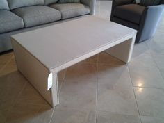 An upholstered cocktail table with nail heads made by Century Furniture