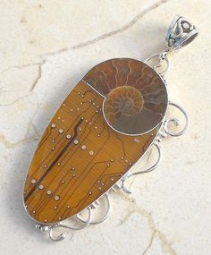 Pendant | Amanda Ethman.  Recycled sterling silver, ammonite and circuit board.