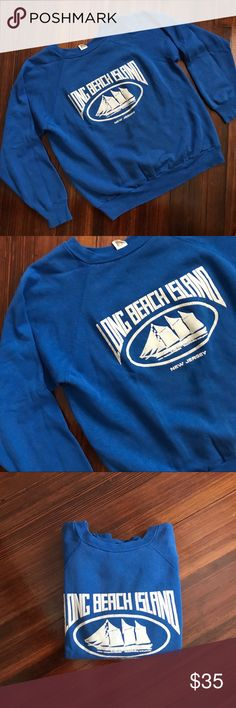 ▪️v i n t a g e : long beach island crewneck v i n t a g e : bright blue pullover crewneck sweatshirt from LBI, Long Beach island. Perfect vintage age and in excellent shape. No flaws or defects whatsoever. Still very bright blue. Warm, comfortable. Size large, can fit a medium/large. —— #shop #freeship #sale #bogo #clearance #deal #gift #present #vintage #vtg #retro #blue #lbi #longbeachisland #newjerseyshore #newjersey #vacation #beach  #souvenir #crewneck #pullover Vintage Sweaters…
