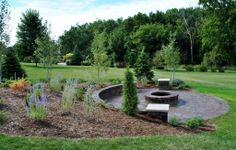 Hillside built-in seating wall with patio and firepit Norland Landscape | Madison Landscape Contractor