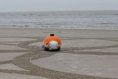 This is the Beachbot, the result of a collaboration between Disney Research and Swiss Engineering school ETH Zurich. It's been specifically designed to drag a tiny rake in the sand while maneuvering around beaches like a canvas, drawing computer-aided designs of Disney characters, or whatever else is loaded into its telemetry.