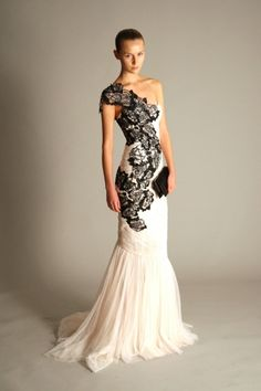 One shoulder dress with stunning black lace detail. This is my dream wedding dress.