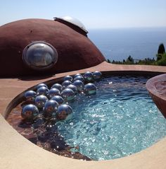 Le Palais Bulles, which incredibly is a real place set into a cliffside halfway between Cannes and Monaco and owned by Pierre Cardin