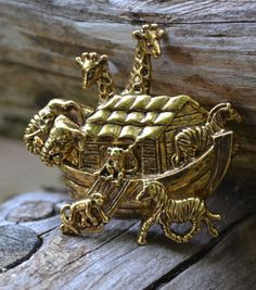 Gold plated Noah's Ark brooch from the 1980s.  Signed Avon.