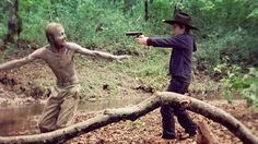 Carl (the little shit) tormenting the walker who will attack Dale later on that day.......