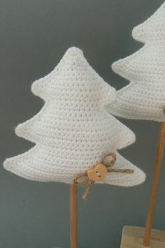 Buy at ravelry, crochet Christmas tree ornaments in white so they show up on a green tree