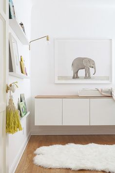 Great idea! - IKEA cabinets hung low for a changing table. Easy access for toddler clothes storage without heavy drawers.
