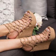 Cut. It Out! These Strings Attached Wedges in taupe feature a faux leather material with a strappy cut out design, a peep toe opening and a platform wedge. Buckle closure at back. Cushioned insole and