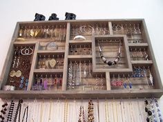 Organize your jewelry using this handmade display case. This earring holder is stained grey in color and made of pine wood. This wall jewelry organizer, display case can be used as an earring holder, necklace holder, bracelet holder, and ring holder. The display case measures 32