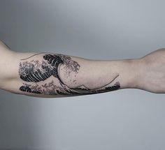 Oozy wave tattoo