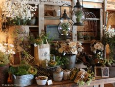 Spring garden display featuring lifelike herbs, lanterns, bird nests, burlap, and more