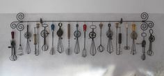 I like this collection of vintage Egg Beaters in the Kitchen. With old recipes on top!