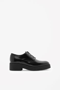 COS   Chunky sole lace-up shoes.  Flat and happy.