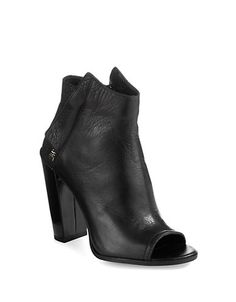 Step up your game with these sleek ankle booties. Featuring side zipper closures and an open toe design, these booties create an edgy, eye-catching look that revs up leggings or dresses.