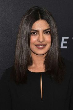 Priyanka Chopra looked absolutely gorgeous and stylish in a relaxed and boho inspired black tunic dress with a thigh grazing hemline, which highlighted her toned legs and a cut out just below the neckline, which teased a hint of her cleavage, while walking the red carpet at the Hands Of Stone premiere held at the SVA Theater on August 22, 2016 in New York City.