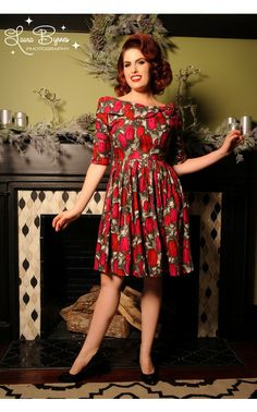 The abstract tulip print of this dress creates a uniquely dreamlike look that is positively spellbinding. The wide off-shoulder collar features a three-dimensional rose on the side, and the gathered waist, full skirt, and invisible zipper on the back creates a flattering fit with romantic appeal. Side pockets are the perfect finishing touch to the blooming beauty.