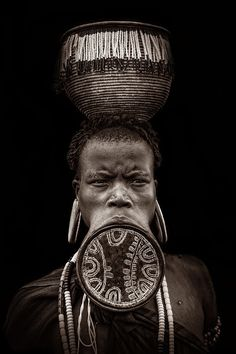 The women of the Mursi tribe in the Omo valley in southern Ethiopia are famous for wearing lip plates. The lip plate is made from clay and inserted into a pierced hole in the lower lip. The lip is pierced around the age of 15 or 18 before a woman gets married. Some plates have a diameter of almost 23cm. I was quite impressed to see these women.