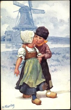Dutch girl & boy are kissing front, big windmill behind - TuckDB Postcards