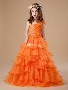 Gorgeous Orange Tulle One Shoulder Floor Length Girls Pageant Dress. Pageant moms know the importance of a fabulous dress when it comes to winning the coveted crown. Points for uniqueness definitely count and your girl will score big ones with this dress. It features a lovely strapless bodice .. . See More Girls Pageant Dresses at http://www.ourgreatshop.com/Girls-Pageant-Dresses-C912.aspx