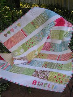 This charm square quilt is so pretty. It would look so cute for a little girls room. I love the color combination in this one.