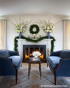 This lovely vignette from At Home Arkansas , is one of my all time favorites. Symmetry, plus blue and white, gets me every time. I lov...