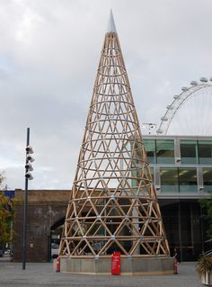 shigeru ban was selected to work with cardboard manufacturer sonoco, constructing a high cone-shaped tower made from hundreds of compressed cardboard tubes. Sustainable Architecture, Contemporary Architecture, Landscape Architecture, Pavilion Architecture, Residential Architecture, Paper Tower, Eco Pods, Wooded Landscaping, Bamboo Structure