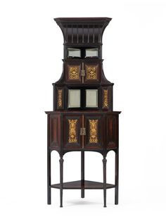 Corner Cabinet; 1873-1874  Edward William Godwin  1873-1874 Stained and gilded rosewood, brass locks. Made by Collinson and Lock