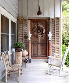 lovin the shutters, door, door knob & antler wreath and light fixture