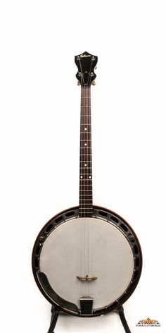 """This is a pre WWII Gibson tenor banjo with single piece flange and 1/2"""" thick rim. It is a suitable project for conversion to five string. It has flat hooks and a simple tension hoop but the flange is good and straight and the armrest shows almost no playing wear. The resonator is arched and bound on the bottom edge only."""