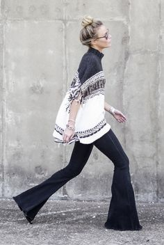 spring / summer - fall / winter - street style - street chic style - casual outfits - fall outfits - navy and white knit fringe poncho + dark denim flare jeans + black wedges + mirror sunglasses