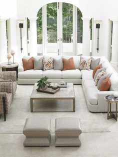 Neutral Living Room with Cathedral Windows. Furniture by Lexington Home Brands, available through Stickley, Audi & Co.