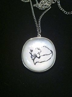 "Arctic fox necklace On 16"" silver coloured chain $14"
