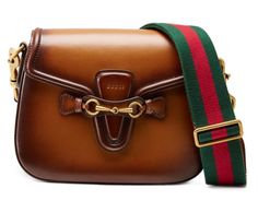 A new bag by Gucci has rolled out. Presenting the Gucci Lady Web Shoulder Bags. Gucci Shoulder Bag, Shoulder Handbags, Leather Shoulder Bag, Shoulder Bags, Shoulder Strap, Gucci Purses, Gucci Handbags, Designer Handbags, Designer Purses
