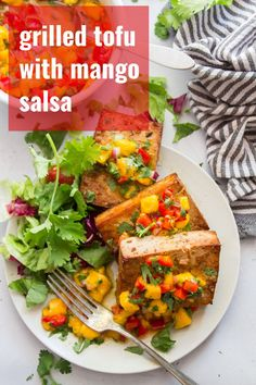 grilled tofu is the flavor-packed vegan main dish your cookouts have been missing! Soaked in a zesty cumin-lime marinade and served with mango salsa, this scrumptious (and easy to make) tofu will be a new summer dinner favorite. Mango Recipes, Veg Recipes, Grilling Recipes, Whole Food Recipes, Barbecue Recipes, Barbecue Sauce, Summer Recipes, Vegan Dinner Recipes, Recipes
