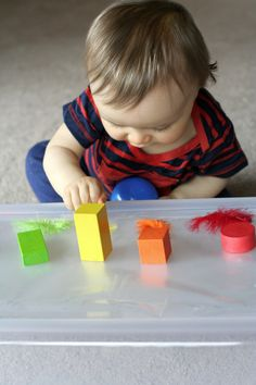 Baby Play:  Exploring Sticky from Fun at Home with Kids.  Clear contact paper with objects placed on top.