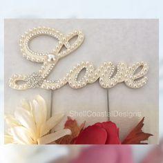 Love Pearl Cake Topper Wedding Cake Topper w/ Swarovski Crystals Traditional Wedding by ShellCoastalDesigns on Etsy https://www.etsy.com/listing/277563590/love-pearl-cake-topper-wedding-cake