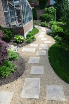 Garden Design And Landscaping, Inspired By Henri Matisse: The curved shape of this pebble path...is in harmony with the rest of the area. The placement of boulders in the way is a wonderful exercise for the use of collagen within the design process.